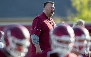 Arkansas coach Bret Bielema watches warmups prior to practice Thursday, Aug. 4, 2016, in Fayetteville.