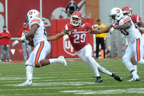 University of Arkansas defender Jared Collins tries to tackle Auburn running back Peyton Collins during Saturdays game October, 24, 2015 against Auburn at Razorback Stadium in Fayetteville.