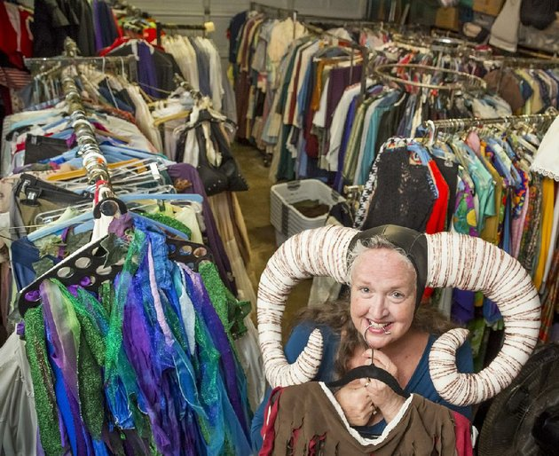 the-costume-lady-debi-manire-shows-off-tim-the-enchanters-antlers-she-made-for-a-production-of-spamalot-her-garage-is-just-one-of-the-spaces-in-her-house-packed-to-the-gills-with-costumes-rather-than-sell-her-pieces-she-hopes-to-help-create-a-theater-cooperative-the-cooperative-feels-like-it-would-serve-more-people-i-feel-strongly-about-that