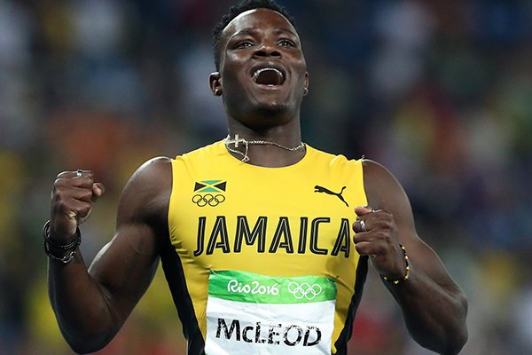 jamaicas-omar-mcleod-celebrates-winning-gold-in-the-mens-110-meter-hurdles-final-during-the-athletics-competitions-in-the-olympic-stadium-of-the-2016-summer-olympics-in-rio-de-janeiro-brazil-tuesday-aug-16-2016-ap-photolee-jin-man