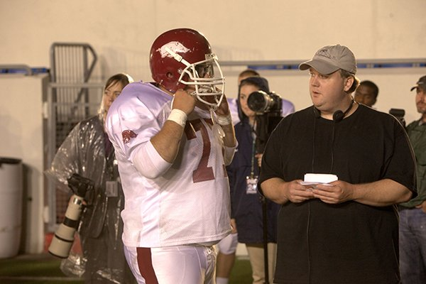 """Actor Chris Severio, left, speaks with David Hunt, director of the film """"Greater"""" during a May 2013 shoot at War Memorial Stadium in Little Rock."""
