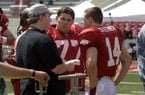 "Director David Hunt, left, speaks with actors Chris Severio, center, and Connor Antico during filming for the movie ""Greater"" on Wednesday, May 29, 2013, at Razorback Stadium in Fayetteville."