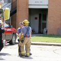 Springdale Firefighters collect equipment and continue an investigation following a structure fire F...