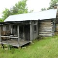 """A cabin built by """"Beaver Jim"""" Villines in 1880 can be seen on the south side of the Ponca low-water ..."""