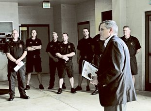 The Sentinel-Record/Colbie McCloud FIRE GRANT: U.S. Rep. Bruce Westerman, R-District 4, right, presents a Federal Emergency Management Agency Assistance to Firefighters Grant of $409,091 to the Hot Springs Fire Department Monday at the Central Fire Station to purchase a live fire training simulator.