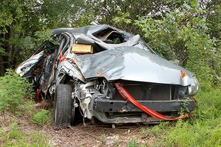 The Sentinel-Record / Max Bryan TAINTED: The mercury-tainted 2009 Mitsubishi Galant that crashed in a Hot Springs Advertising and Promotion Commission parking lot in the 300 block of Malvern Avenue on May 16 currently sits marked off in Combs & Burks Wrecker Service's impound lot.