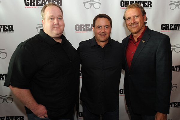 "Director David Hunt (from left) poses Tuesday, Aug. 23, 2016, with producer Brian Reindl, and Marty Burlsworth, brother of Brandon Burlsworth, during a red carpet event ahead of the premiere of the movie ""Greater"" at the Malco Razorback Cinema 16 in Fayetteville."