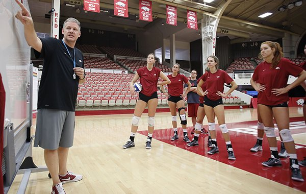 Arkansas volleyball coach Jason Watson talks to players during practice Friday, Aug. 19, 2016, at Barnhill Arena in Fayetteville.