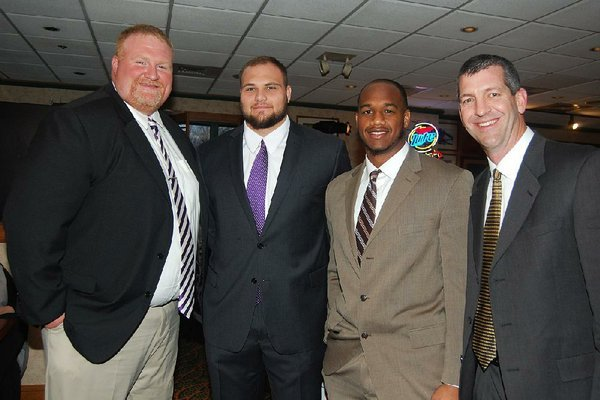 Arkansas Democrat-Gazette/HELAINE R. WILLIAMS  Brett Shockley, Offensive line/ tight ends coach at Ouachita Baptist University in Arkadelphia, Ouachita Baptist left tackle Mike Russell;  Trevon Biglow, defensive lineman, Harding University in Searcy; and Harding assistant Coach Paul Simmons at the Little Rock Touchdown Club's 12th annual Awards Banquet featuring Darren McFadden, held Feb. 11 in the  ballroom of the Embassy Suites Little Rock.