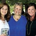 Barb Putman (from left), Denise Garner and Jennifer Irwin visit at the TheatreSquared season kickoff...