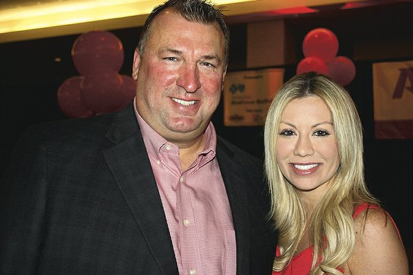 NWA Democrat-Gazette/CARIN SCHOPPMEYER Razorback football head coach Bret and Jen Bielema stand for a photo at the Razorback football kickoff luncheon Aug. 19 at the Northwest Arkansas Convention Center in Springdale.