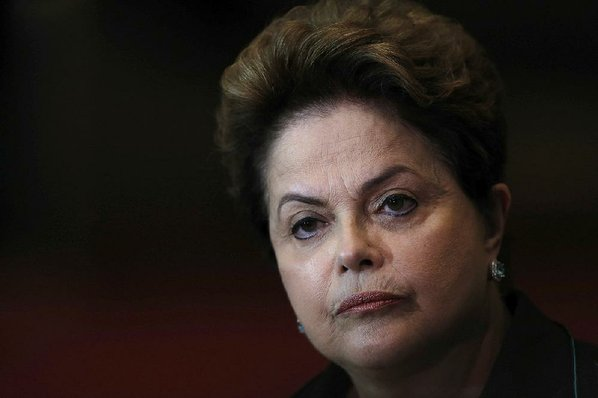 Brazil's Rousseff holds back anger at question