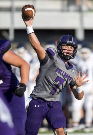 Fayetteville senior quarterback Taylor Powell looks to pass Aug. 22 during a scrimmage against Greenwood at Harmon Field in Fayetteville.