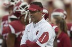 Arkansas offensive coordinator Dan Enos watches warmups prior to a game against Texas Tech on Saturday, Sept. 19, 2015, at Razorback Stadium in Fayetteville.