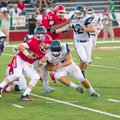 Max Frazier of Northside (left) takes a hit from Greenwood defender Austin Collins while rushing the...