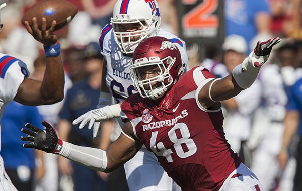 Arkansas defensive end Deatrich Wise rushes Louisiana Tech quarterback J'mar Smith during a game Saturday, Sept. 3, 2016, in Fayetteville.