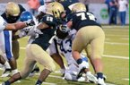 Pulaski Academy junior offensive lineman Luke Jones (72) pancakes a defender. (photo courtesy of Sheldon Smith)