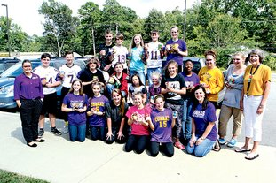 The Sentinel-Record/Richard Rasmussen FLOOD RELIEF: Teachers and students in the Fountain Lake Middle School seventh- and eighth-grade Service Projects class gather Thursday with a truckload of nonperishable food items they collected over the past 10 days. The class sent out fliers and contacted area churches seeking donations to send to Live Oak Middle School in Watson, La., in Livingston Parish. The area was hit hard by the recent flooding.