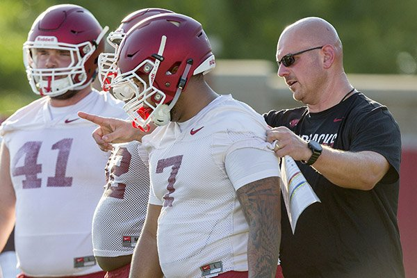 Briston Guidry, freshman defensive lineman, and defensive line coach Rory Segrest