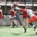 Springdale quarterback Layne Hutchins (left) slips past Russellville defender Layton Bicanovsky for ...