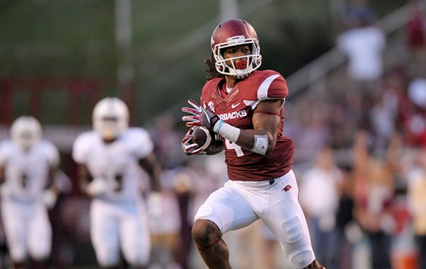 Arkansas receiver Keon Hatcher runs after catching a pass in the first quarter of the Razorbacks' game against Texas State on Saturday, Sept. 17, 2016, in Fayetteville.