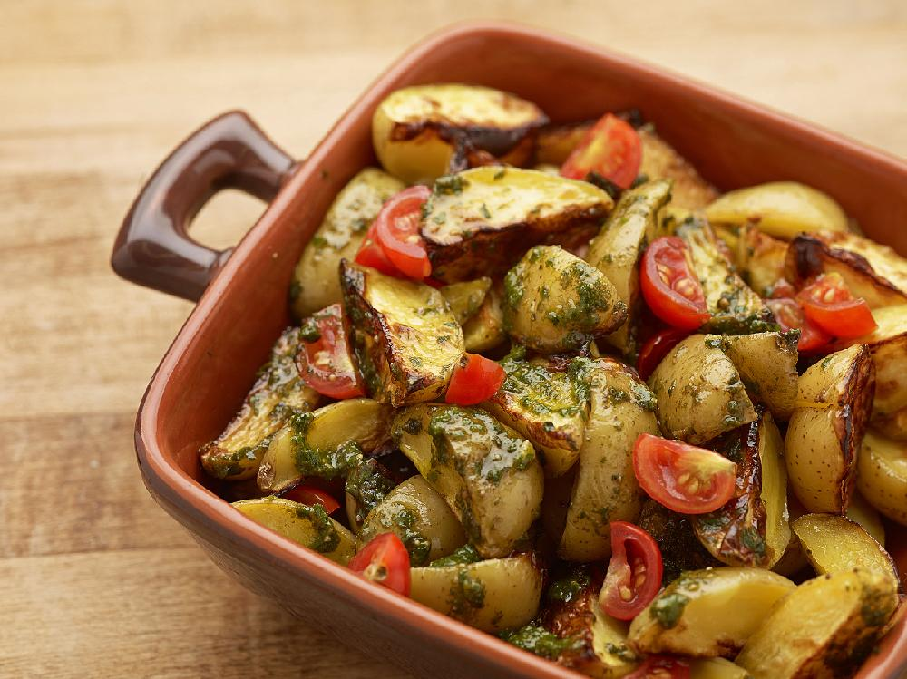 Oven Roasted Red Potatoes With Pesto And Tomatoes