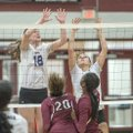Mary Grace Heil (18) and Abbie Kathol (1) of Fayetteville defend a Springdale shot Tuesday at Bulldo...