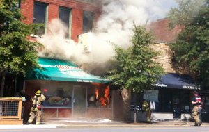 Arkansas Democrat-Gazette/WALTER WEBB  FILE — Smoke and flames poured out of the front of Midtown Billiards in September 2016.