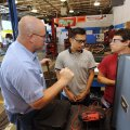 Dempsey Brown (from left), automotive department chairman at Northwest Technical Institute, answers ...