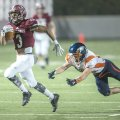 Kyler Williams (3) of Springdale slips away from Cameron Gibson (10) of Rogers Heritage for a long t...