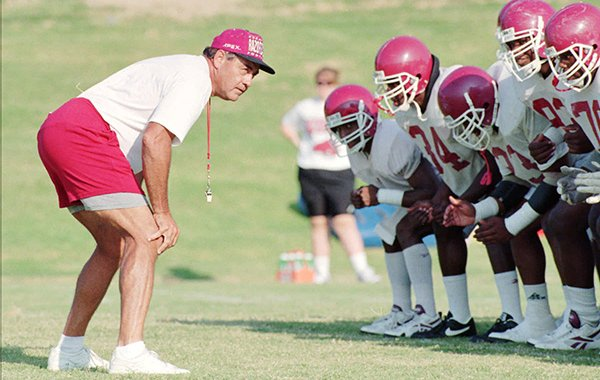 Arkansas Offensive Line coach Mike Bender, left, puts his players through drills during practice on Aug. 15, 1995. (AP Photo/Gary Yandell)