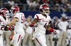 Arkansas wide receiver Keon Hatcher (4) runs off the field celebrating his touchdown catch in the first half of an NCAA college football game against Texas A&M on Saturday, Sept. 24, 2016, in Arlington, Texas. (AP Photo/Tony Gutierrez)