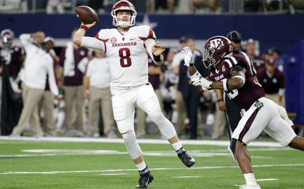 Arkansas quarterback Austin Allen (8) throws the ball under pressure from Texas A&M defensive back Armani Watts (23) in the first half of an NCAA college football game, Saturday, Sept. 24, 2016, in Arlington, Texas. (AP Photo/Tony Gutierrez)