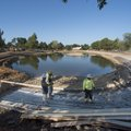 A construction crew works on laying rebar Friday as they work to create walls and improve Murphy Par...
