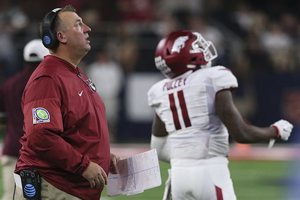 Arkansas coach Bret Bielema watches a replay after safety De'Andre Coley was flagged for targeting during a game against Texas A&M on Saturday, Sept. 24, 2016, in Arlington, Texas.