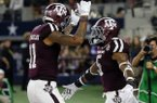 Texas A&M wide receiver Josh Reynolds (11) and running back Trayveon Williams (5) celebrate a touchdown run by Williams during the second half of an NCAA college football game against Arkansas on Saturday, Sept. 24, 2016, in Arlington, Texas. (AP Photo/Tony Gutierrez)