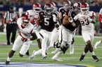 Texas A&M running back Trayveon Williams (5) sprints past Arkansas defensive back De'Andre Coley, left, and linebacker Dre Greenlaw (23) for a touchdown during the second half of an NCAA college football game, Saturday, Sept. 24, 2016, in Arlington, Texas. (AP Photo/Tony Gutierrez)