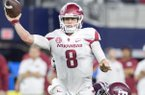 Arkansas quarterback Austin Allen throws while being hit in Saturday's 45-24 loss to Texas A&M.