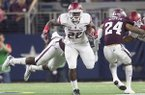 Arkansas running back Rawleigh Williams carries the ball during a game against Texas A&M on Saturday, Sept. 24, 2016, in Arlington, Texas.