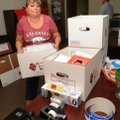 Lora Markham-Brown with the Benton County prosecutor's office, stacks boxes Friday during the move f...