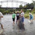 Fish aficionados including Michael Gaines (from left), Johnathan Gaines and Denny Rogers see what sp...