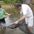 Johnathan Gaines, 12, and his dad, Michael Gaines see what they've caught Sept. 10 in their seine. M...