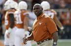 Texas head coach Charlie Strong watches his players warm up before a NCAA college football game, Saturday, Sept. 10, 2016, in Austin. (AP Photo/Eric Gay)
