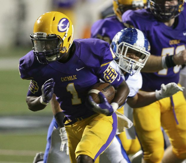 arkansas-democrat-gazettestaton-breidenthal-92916-catholics-samy-johnson-left-runs-past-bryant-defender-aj-williams-for-a-touchdown-thursday-night-during-their-game-at-war-memorial-stadium
