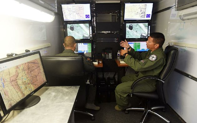 members-of-the-188th-wing-of-the-arkansas-air-national-guard-use-a-simulator-thursday-at-their-base-in-fort-smith-to-demonstrate-their-remote-piloted-role-in-combat-missions
