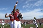Arkansas running back Devwah Whaley points to the sky after scoring a touchdown during a game against Alcorn State on Saturday, Oct. 1, 2016, at War Memorial Stadium in Little Rock.