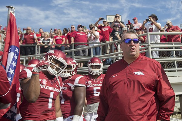 Arkansas coach Bret Bielema prepares to run onto the field with his team prior to a game against Alcorn State on Saturday, Oct. 1, 2016, at War Memorial Stadium in Little Rock.