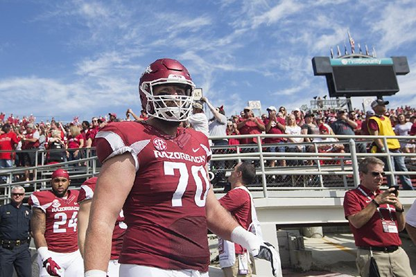 Arkansas offensive lineman Dan Skipper takes the field prior to a game against Alcorn State on Saturday, Oct. 1, 2016, at War Memorial Stadium in Little Rock.