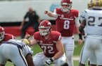 Arkansas' Austin Allen and Frank Ragnow point to blocking assignments before a play during the second quarter of the NCAA football game against Alcorn St. on Saturday, Oct. 1, 2016, in Little Rock, AR. Arkansas beat Alcorn St., 52-10. (AP Photo/Chris Brashers)