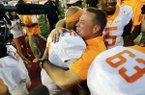 FILE - In this Oct. 1, 2016, file photo, Tennessee head coach Butch Jones hugs quarterback Joshua Dobbs (11) after defeating Georgia 34-31 in an NCAA college football game, in Athens, Ga. Dobbs completed a last-second pass to wide receiver Jauan Jennings to give Tennessee the victory. Dobbs has stepped up his play in the second half all season while leading Tennessee back from double-digit deficits in four of its first five games.(AP Photo/John Bazemore, File)